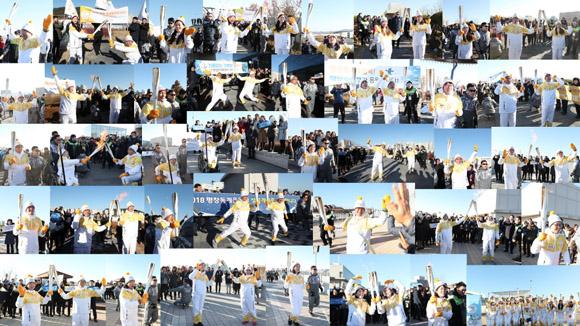 12월 13일 오후 세종특별자치시 정부세종청사 옥상정원에서 주자로 나선 세종청사에서 일하는 공무원들이 직장 선후배 및 기족들의 응원을 받으며 '2018 평창동계올림픽 성화 봉송'을 하고 있다. (사진 = 국민소통실)