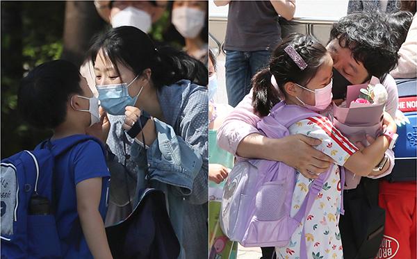 코로나19가 만든 초등학생 부모님들의 마스크 '뽀뽀' (사진=저작권자(c) 연합뉴스, 무단 전재-재배포 금지)